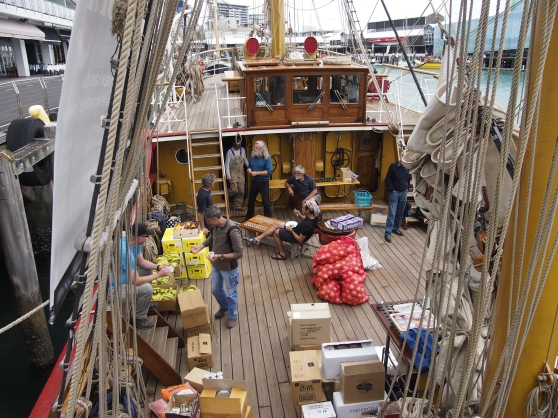 Bark Europa mid-deck during provisioning, Auckland [Captain Klaas centre long grey hair and beard]