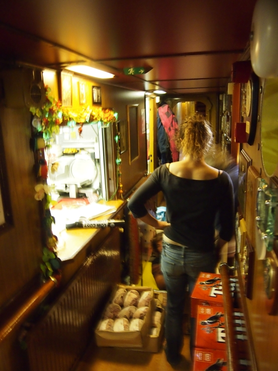 Loading provisons below in the store rooms on board Europa, Auckland Harbour