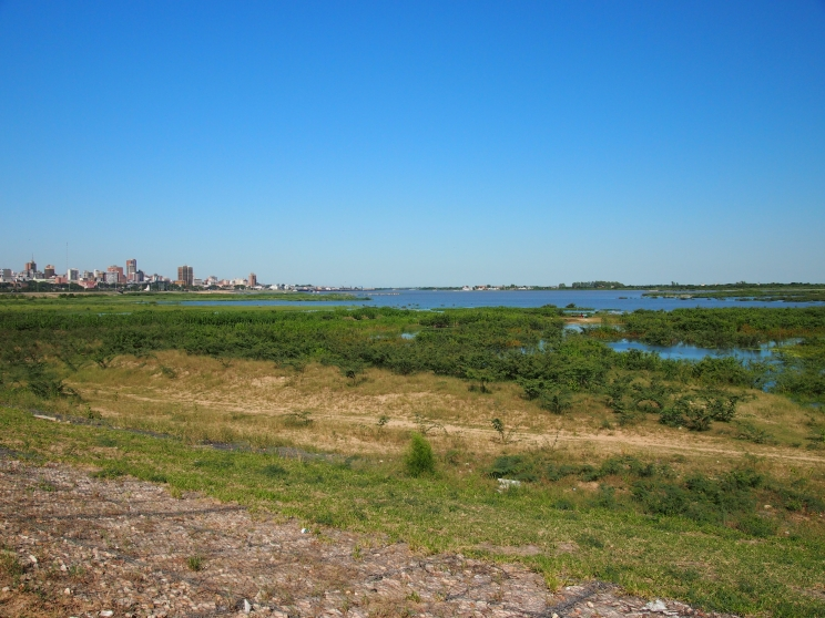 Dengue fever lurks in Paraguay (Central Asuncion and the edge of the new Coastal Avenue built over the swampy foreshores of the lagoon that splits off from the Paraguay River)